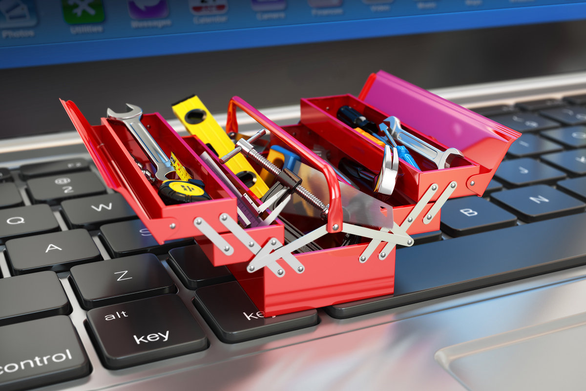 tools_tiny_toolbox_toolkit_on_laptop_keyboard_by_bet_noire_gettyimages_1200x800-100756958-large
